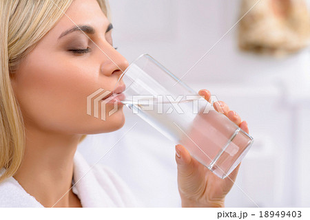 Young lady drinking water.